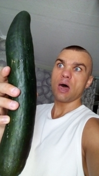 Man with a huge cucumber